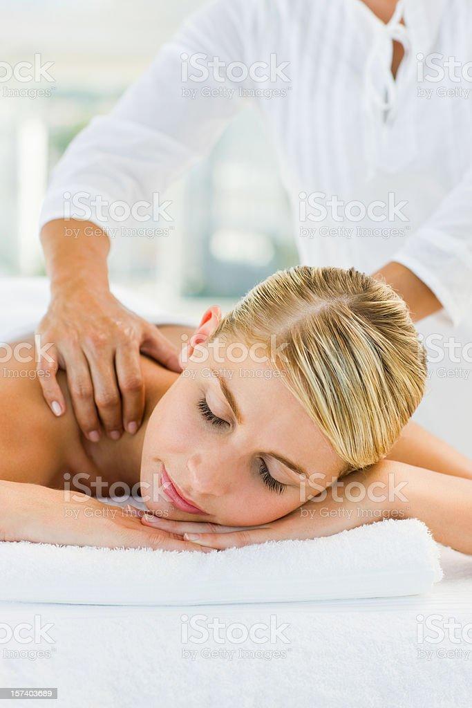 Beautiful female enjoying a massage at spa royalty-free stock photo