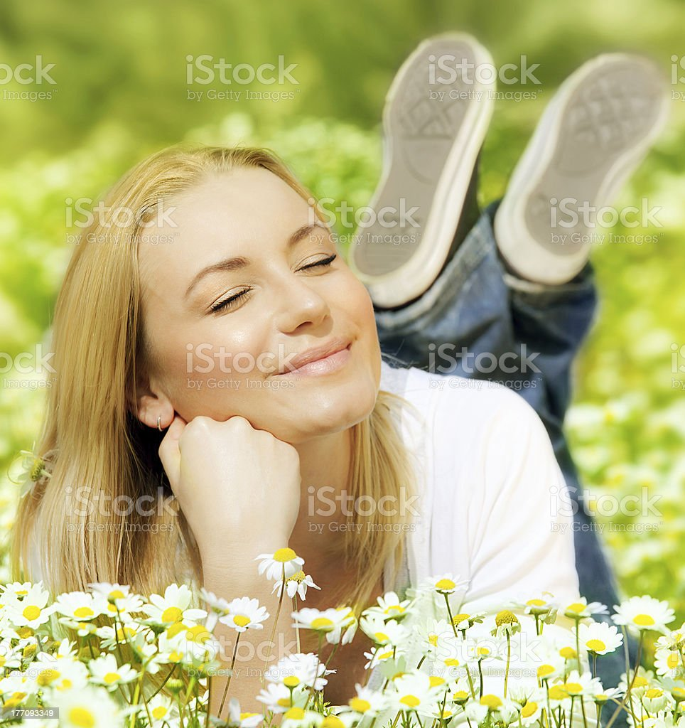 Beautiful female enjoying flower filed royalty-free stock photo