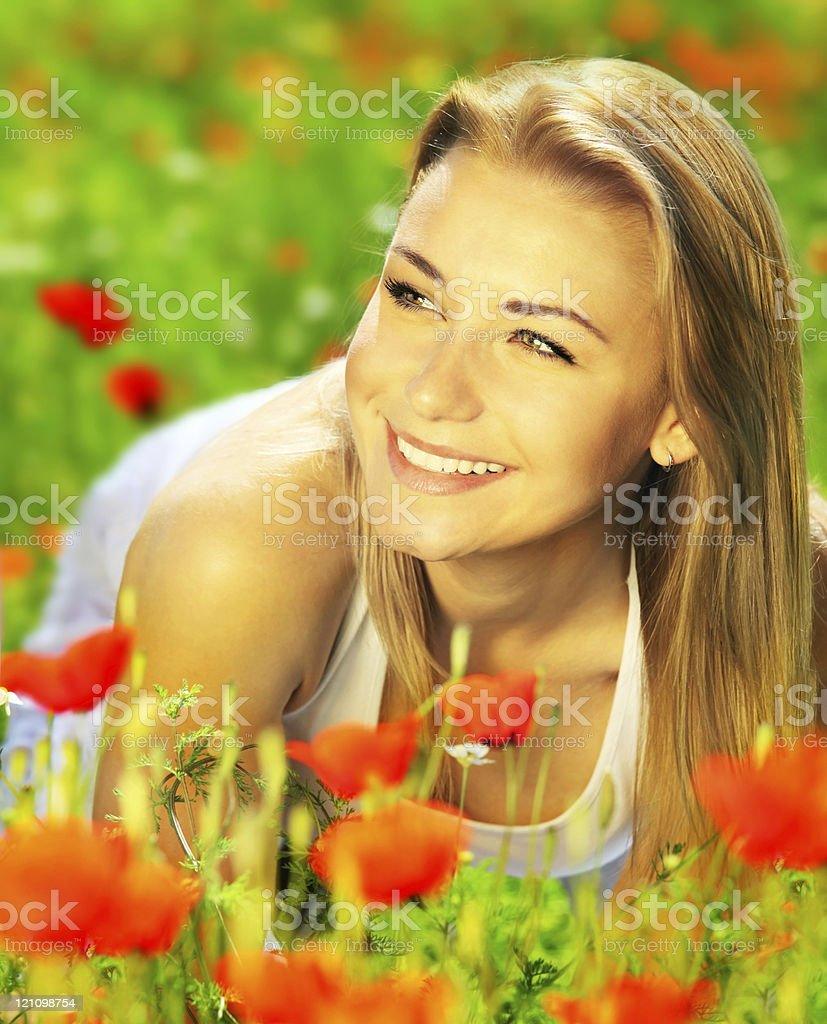 Beautiful female enjoying on the flower field royalty-free stock photo