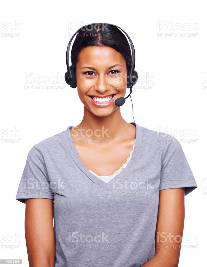 Beautiful female executive wearing headset and smiling stock photo