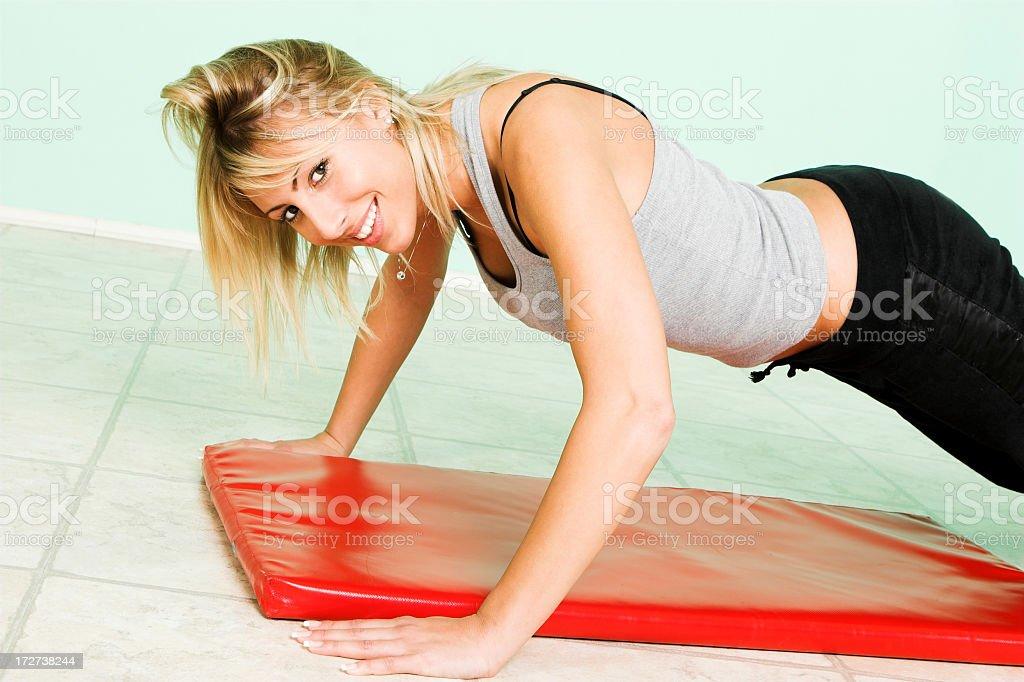 Beautiful female exercising royalty-free stock photo