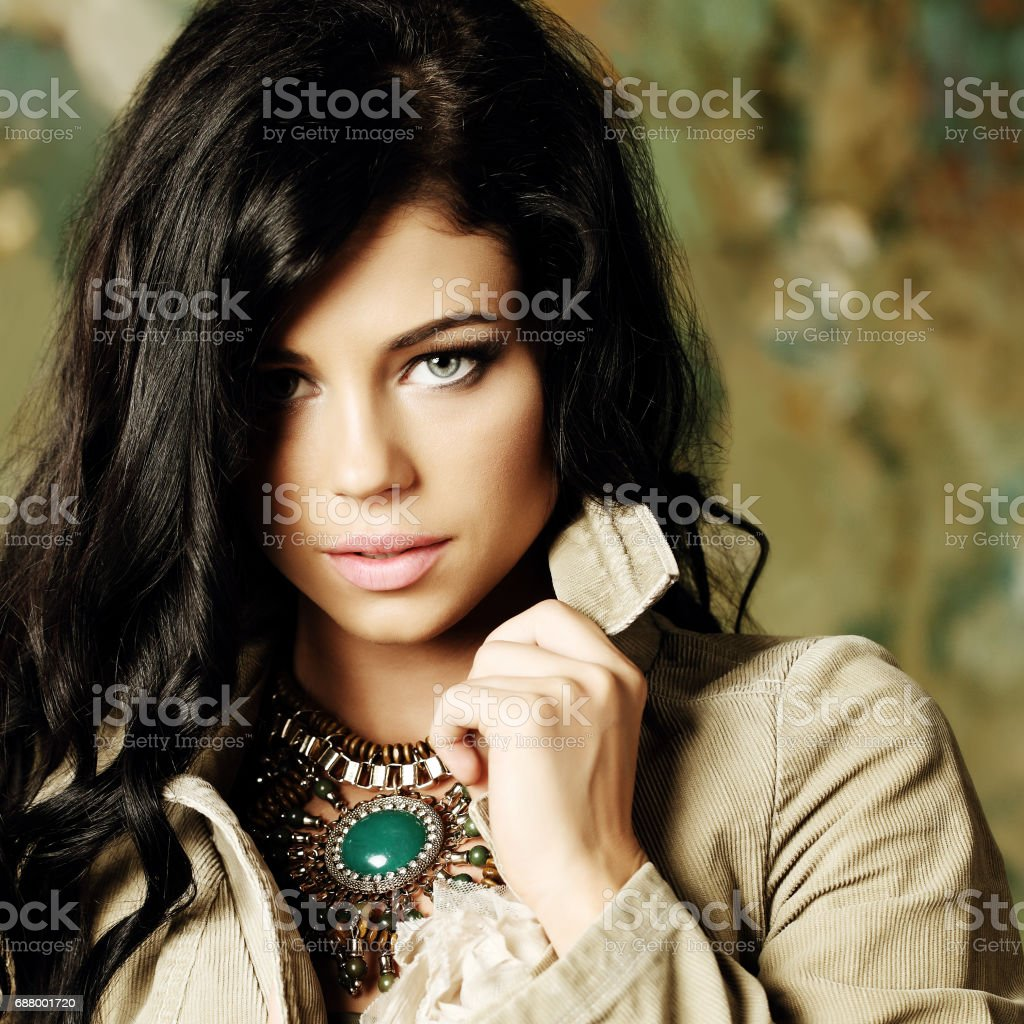 Beautiful female face, model with professionale makeup and curly hair stock photo