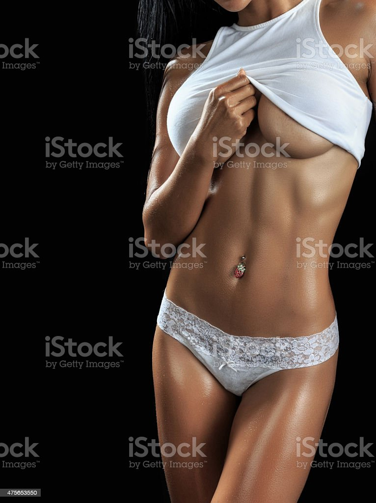 Beautiful female fitness model stock photo