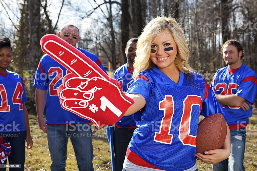 Beautiful female football fan stock photo