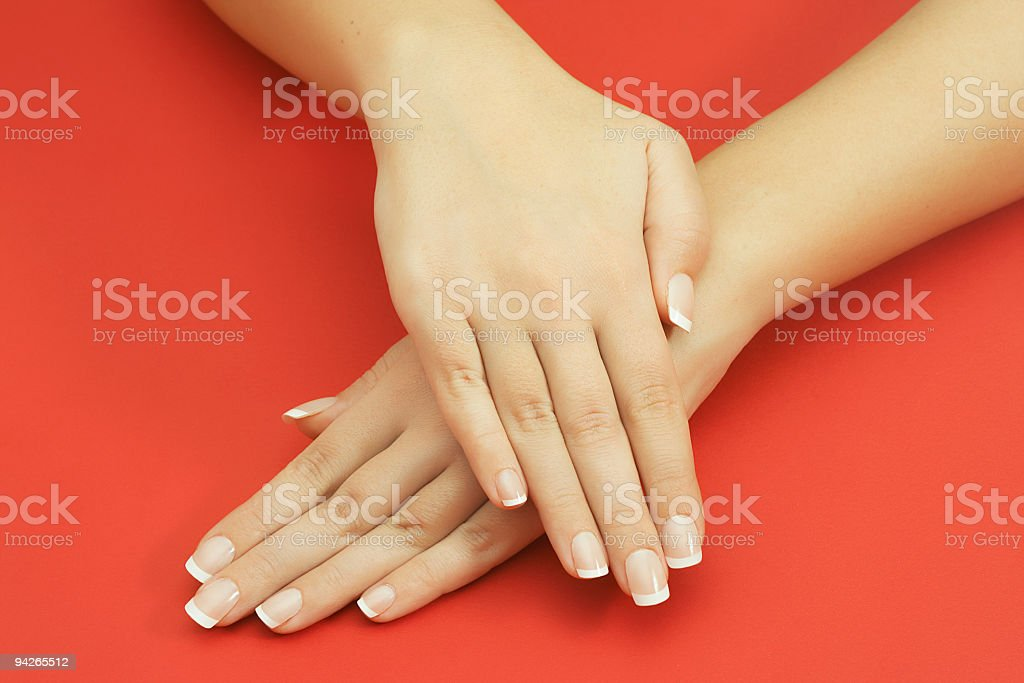 Beautiful female hands on red background royalty-free stock photo
