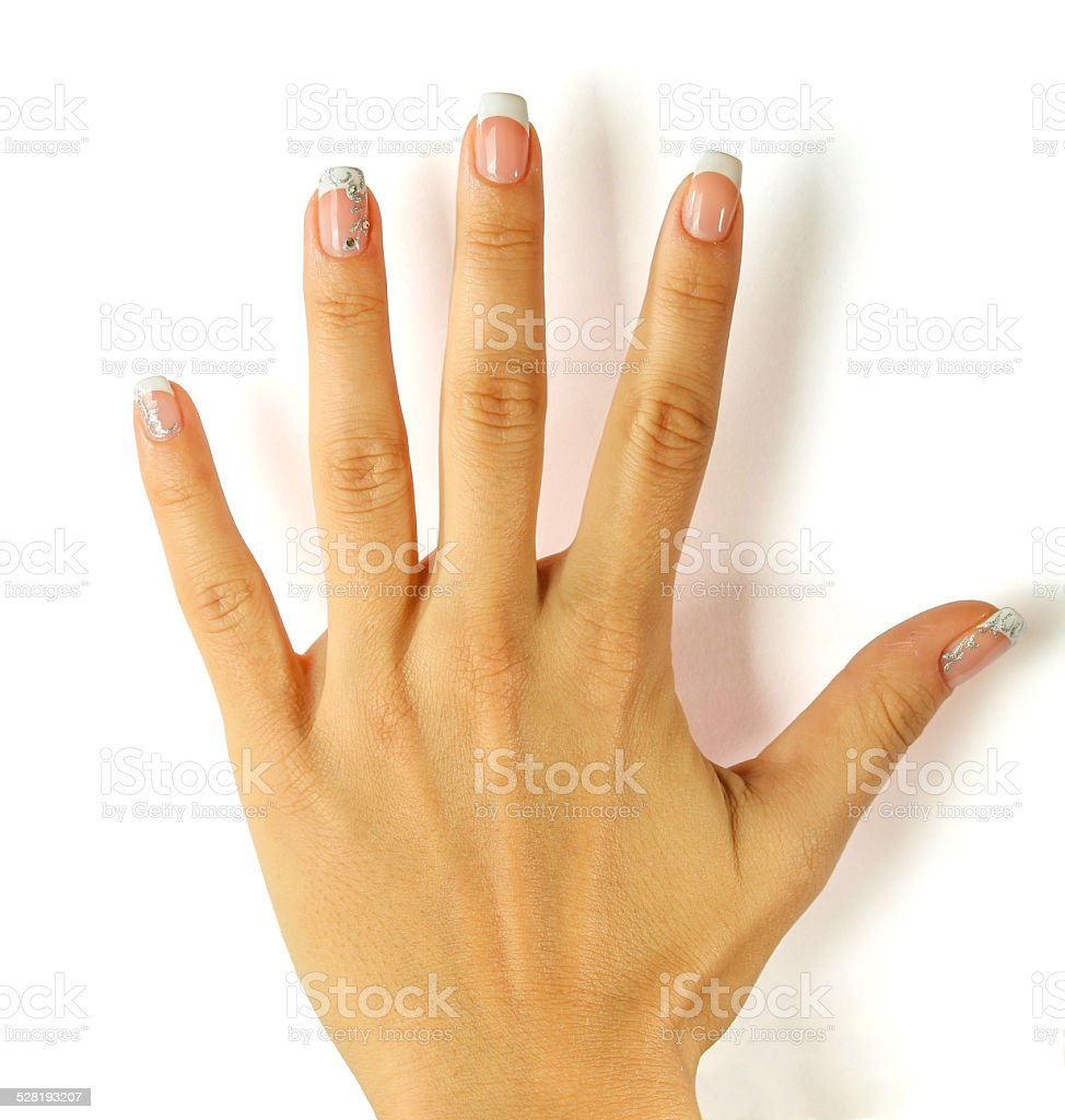 Beautiful female hands with french manicure isolated on white stock photo