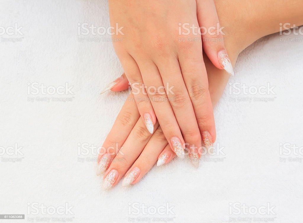 Beautiful female hands with french manicure stock photo