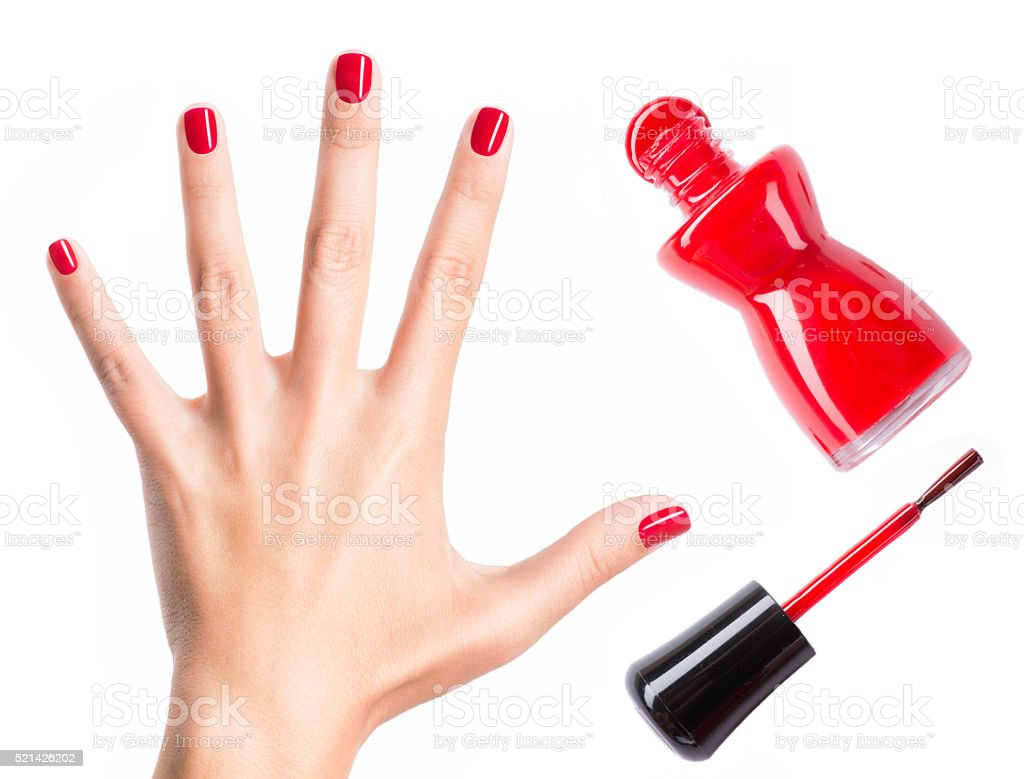 Beautiful female hands with red manicure stock photo