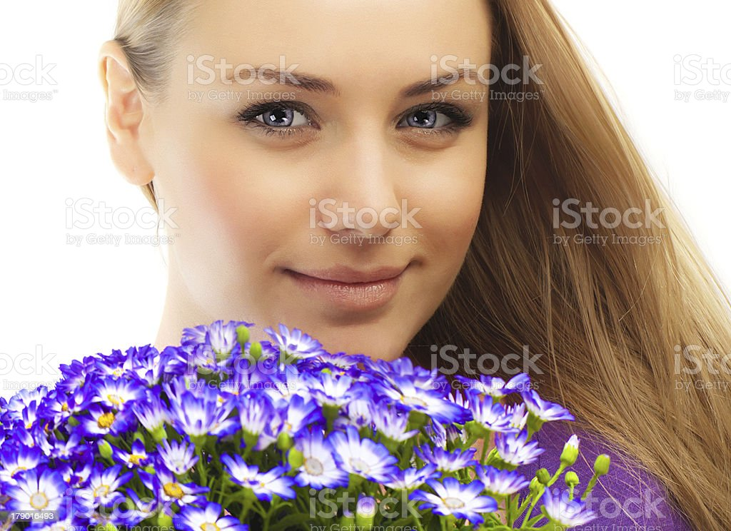Beautiful female holding flowers royalty-free stock photo