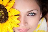 Beautiful female holding sunflower