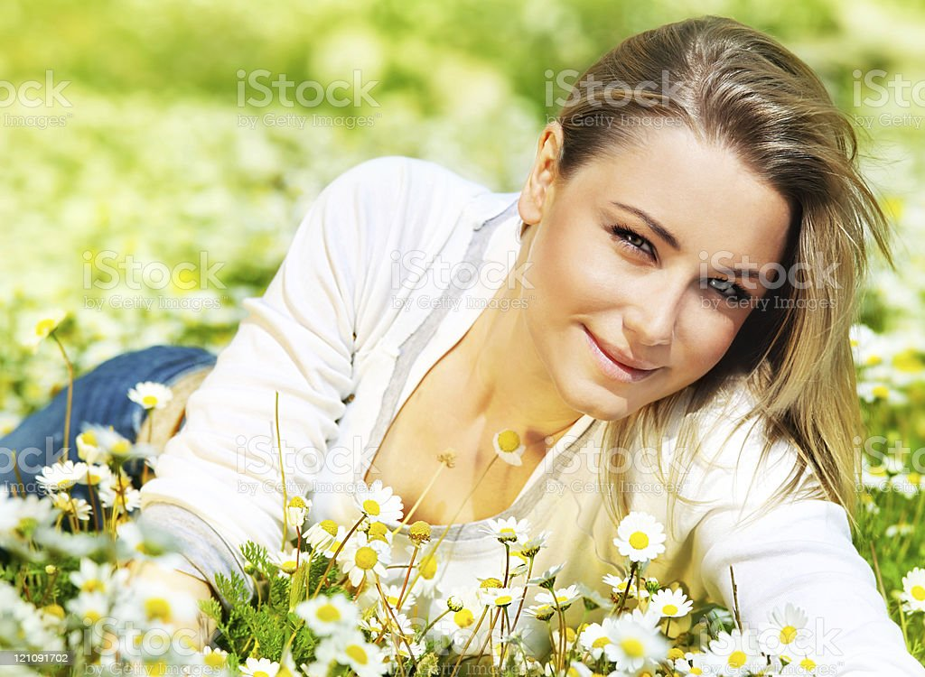 Beautiful female laying on the flower filed royalty-free stock photo