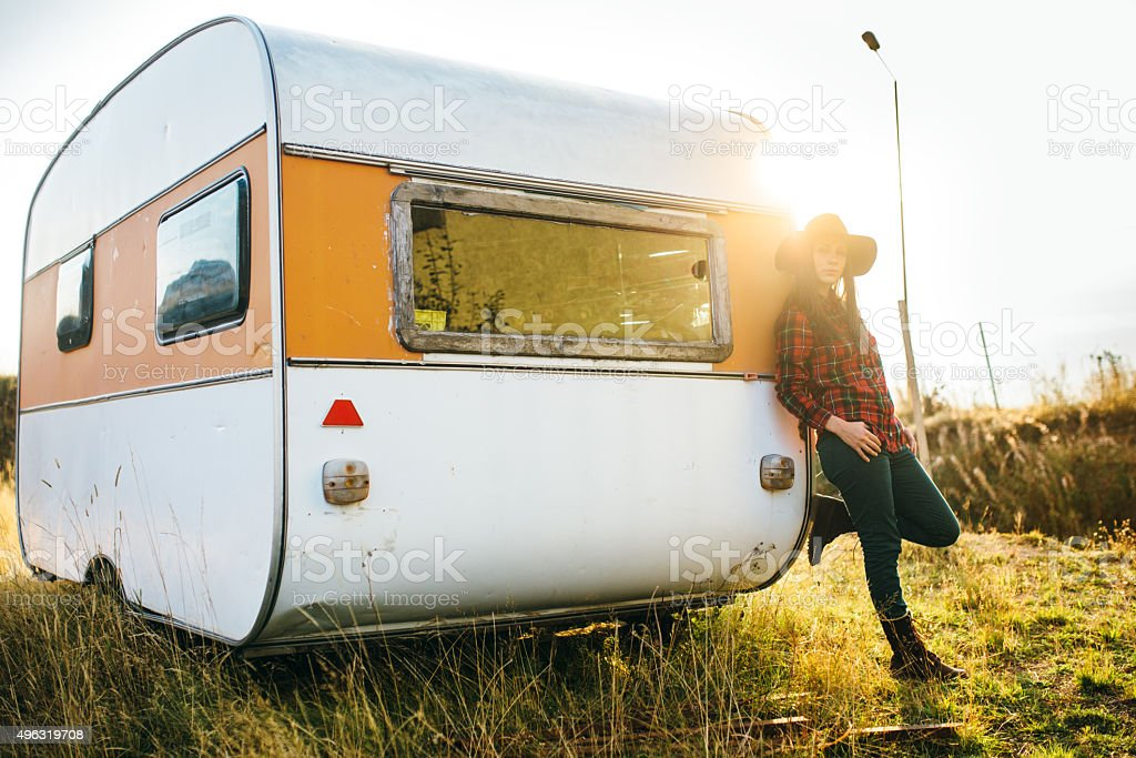 Beautiful female leaning on the car trailer stock photo