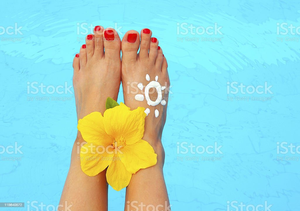 Beautiful female legs in the pool royalty-free stock photo