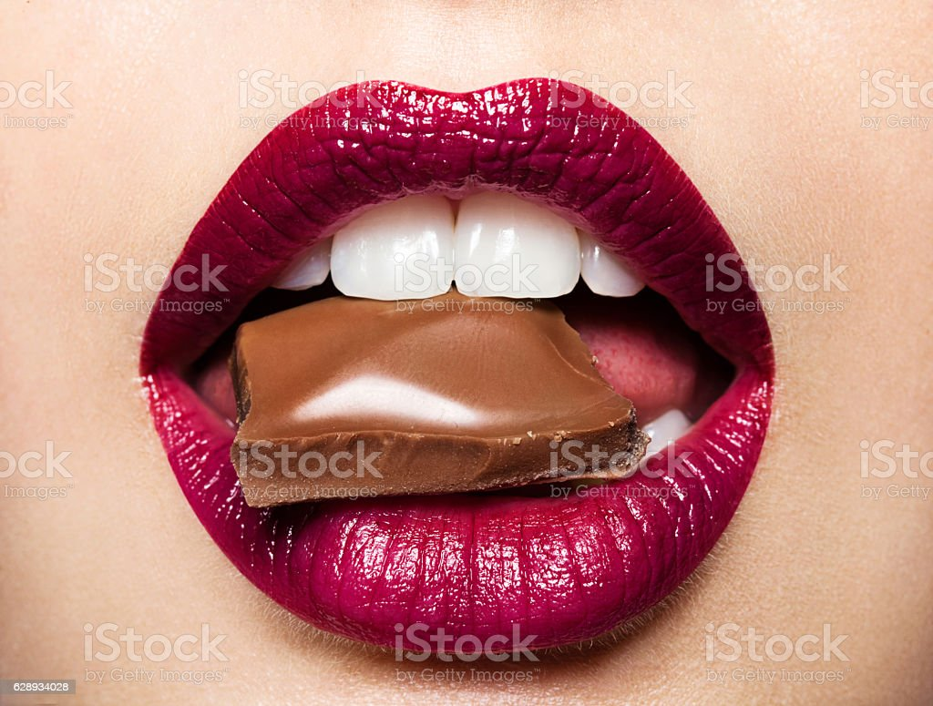 Beautiful female lips with chocolate stock photo