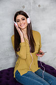 Beautiful female listening music