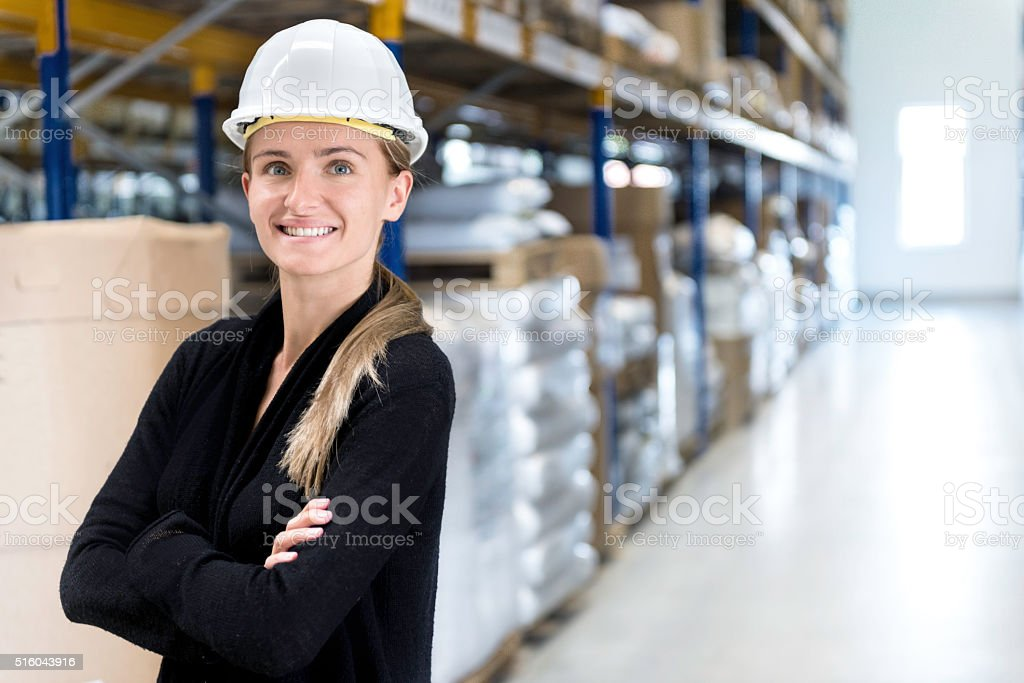 Beautiful female manual worker stock photo