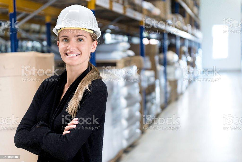 Beautiful female manual worker stock photo