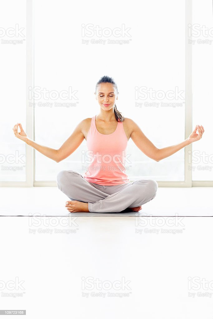 Beautiful female meditating in the lotus position royalty-free stock photo