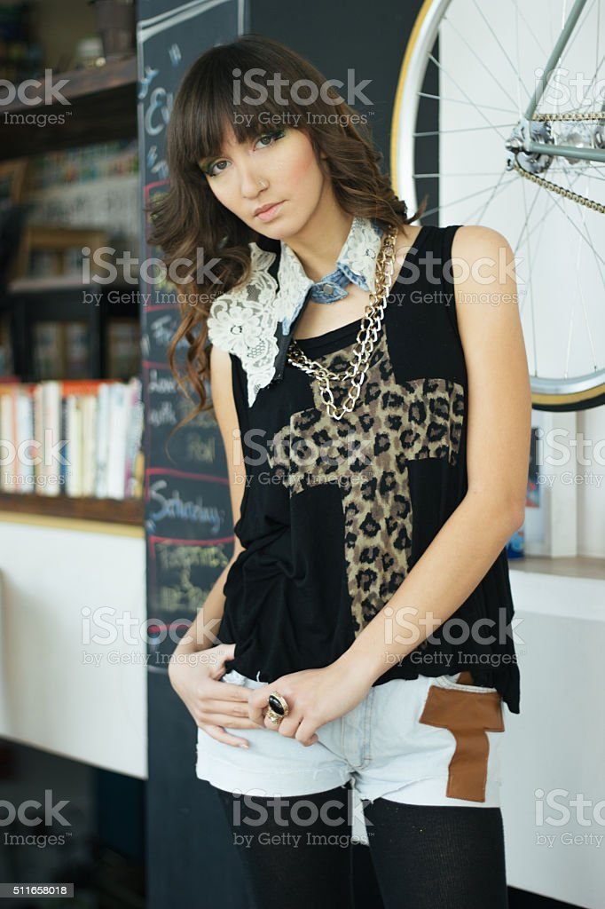 Beautiful female model in hipster clothes stock photo