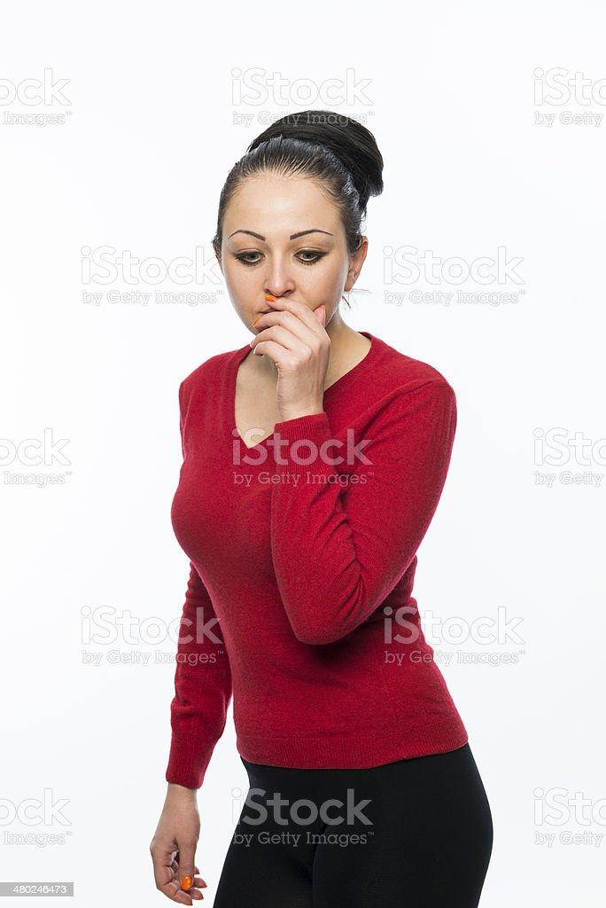 Beautiful female model wearing red jumper stock photo