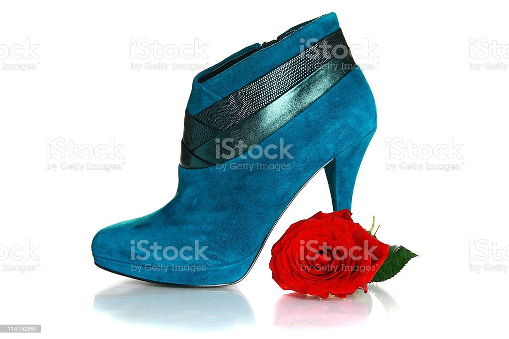 Beautiful female shoes with high heels and flower. royalty-free stock photo