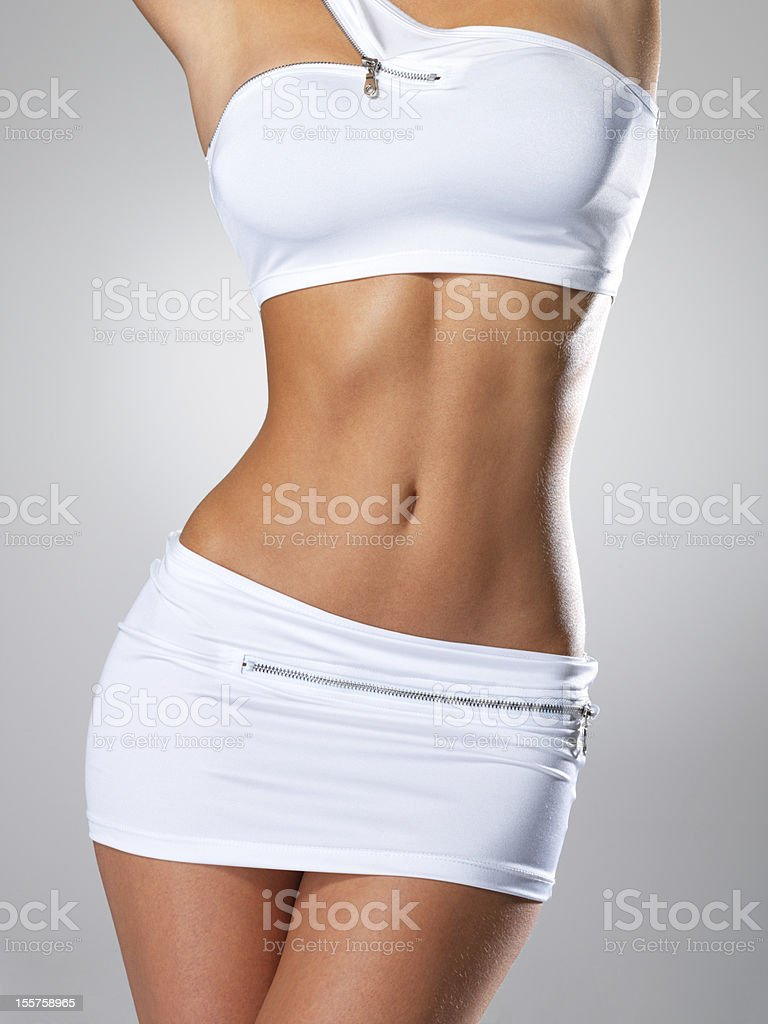 Beautiful female slim tanned body royalty-free stock photo
