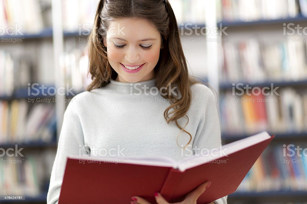 Beautiful female student reading a book royalty-free stock photo
