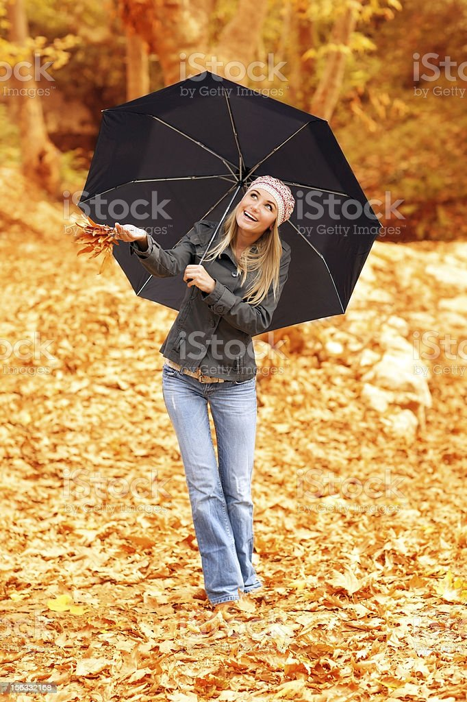 Beautiful female under umbrella royalty-free stock photo