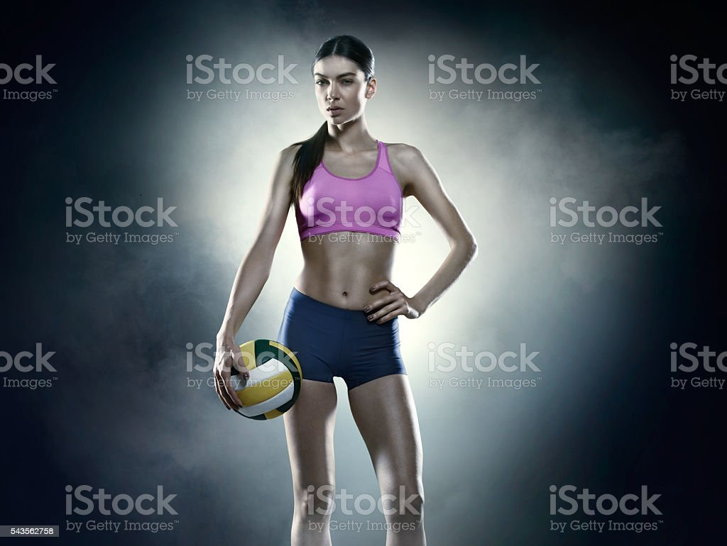 Beautiful female volleyball player stock photo