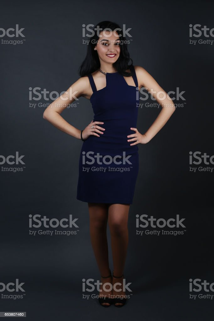 Beautiful female wearing a blue dress stock photo