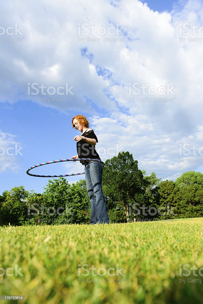 Beautiful Female with Hula-Hoop royalty-free stock photo