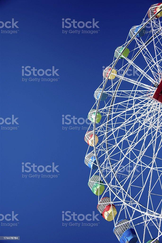 Beautiful Ferris wheel at funfair with deep blue sky royalty-free stock photo