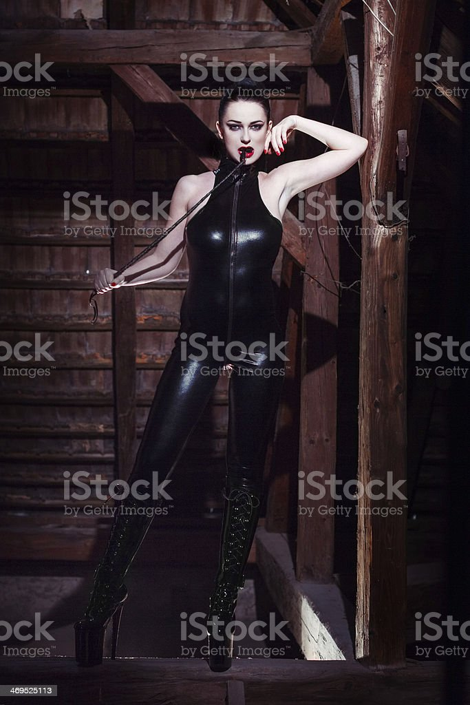 Beautiful fetish model with whip royalty-free stock photo