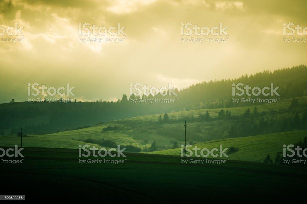 A beautiful field scenery of Slovakia. Warm summer haze, colorful contrast look. stock photo