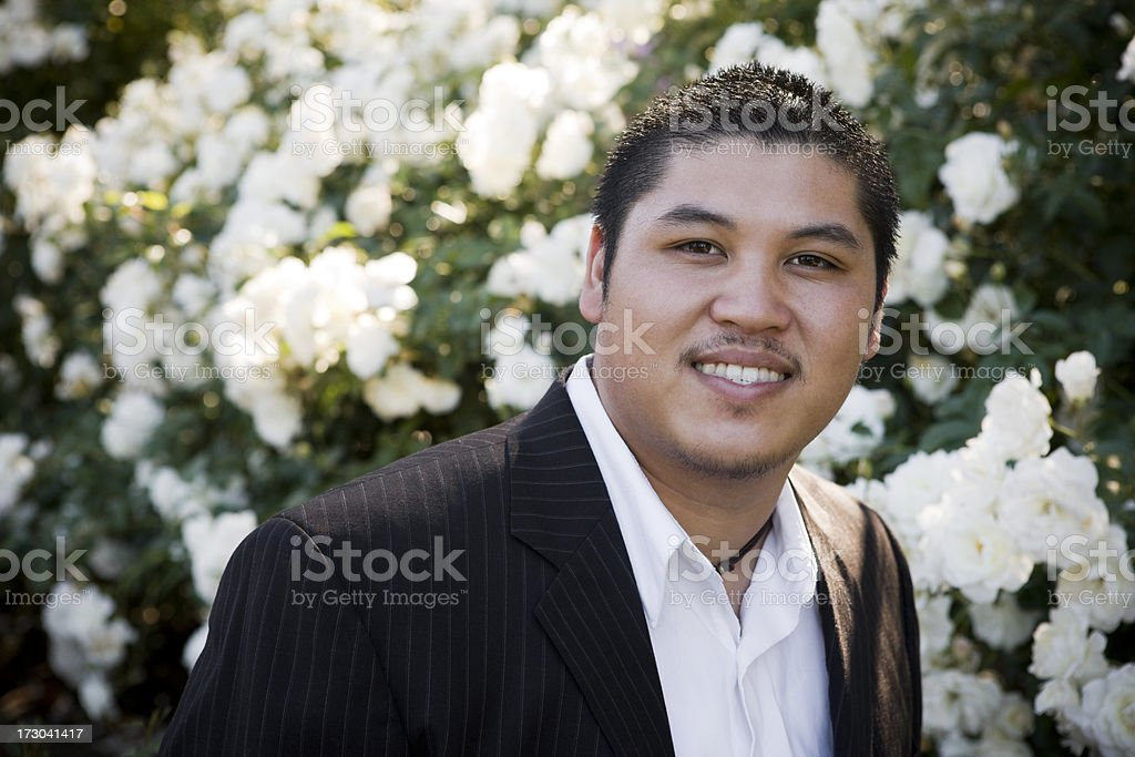 Beautiful Filipino Young Man Portrait in Suit, Outdoor Garden, Copyspace stock photo