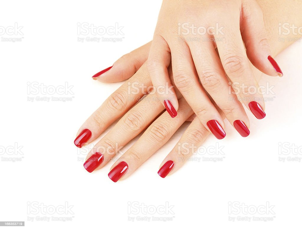Beautiful fingernails painted in red. stock photo