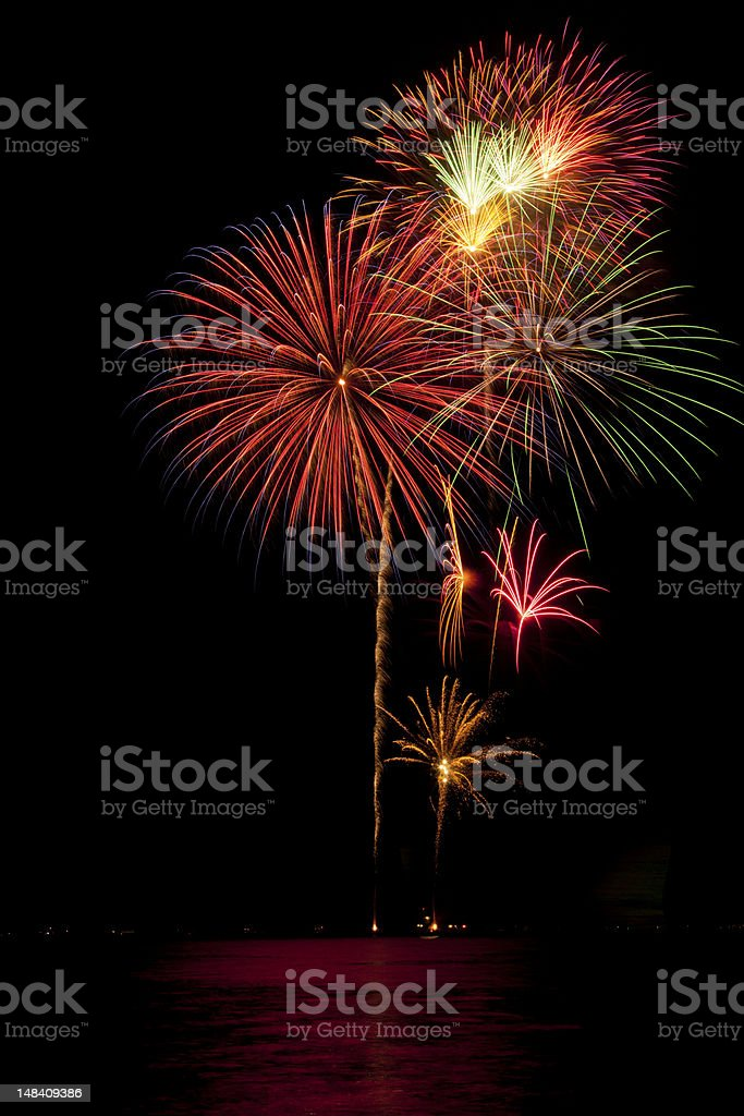 Beautiful fireworks on black sky with reflections in lake royalty-free stock photo