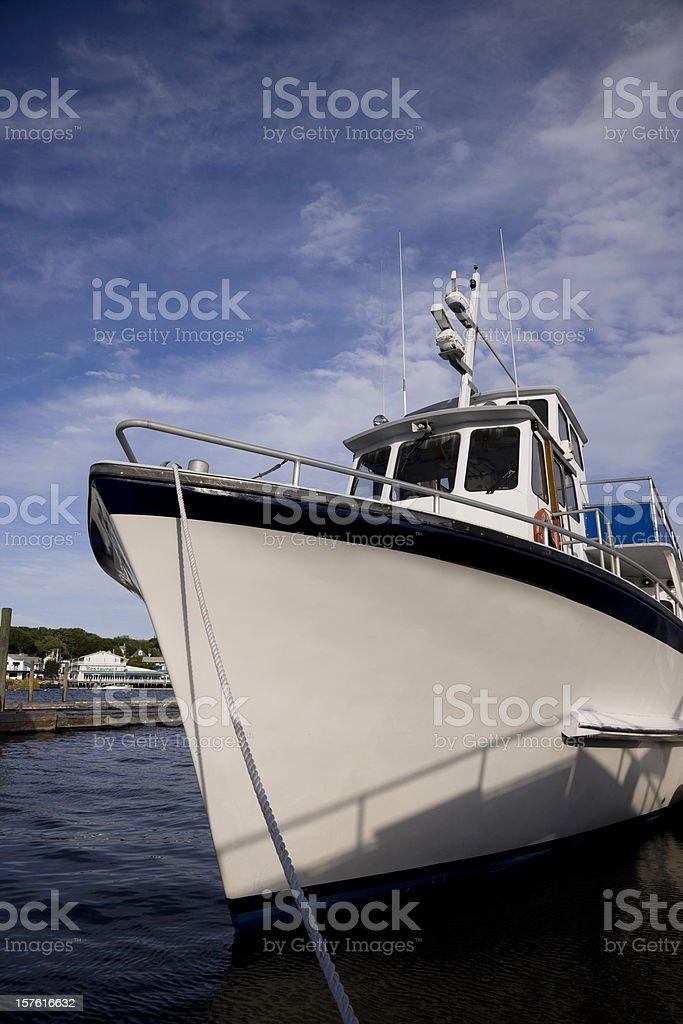 Beautiful fishing motor boat at the dock royalty-free stock photo