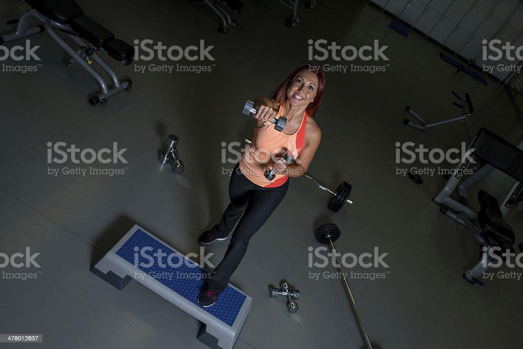 Beautiful fit girl exercising royalty-free stock photo
