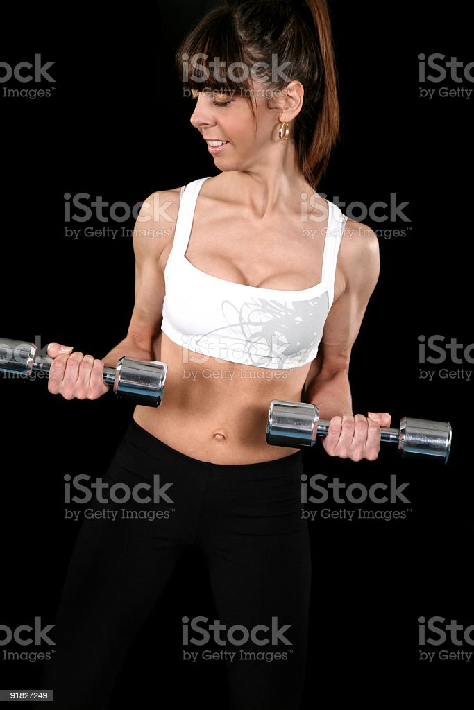 Beautiful fit girl exercising royalty-free stock photo