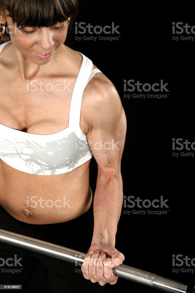 Beautiful fit girl exercising-isolated on black background royalty-free stock photo