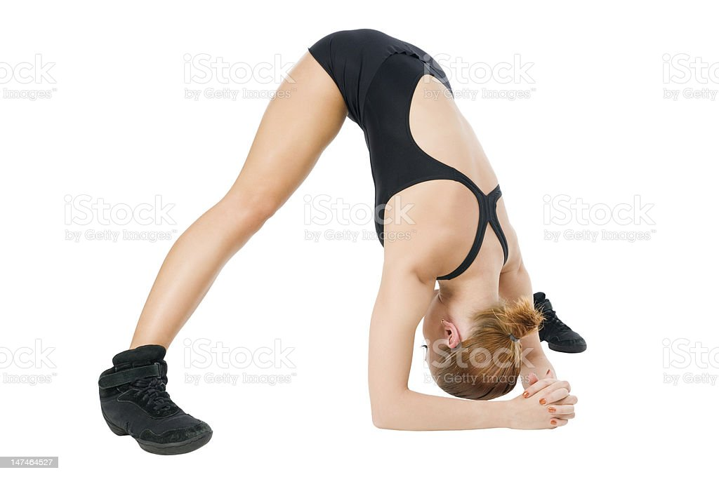 Beautiful fit red girl practicing yogatic pose stock photo