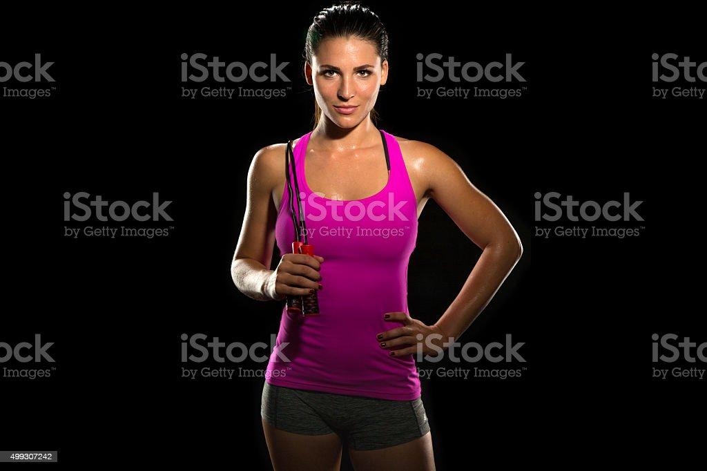 Beautiful fit thin slim toned female body jump rope athlete stock photo