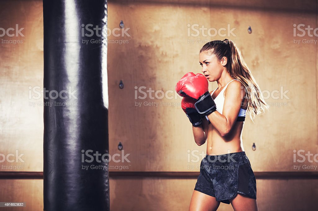 Beautiful Fitness Woman Boxing with Red Gloves stock photo