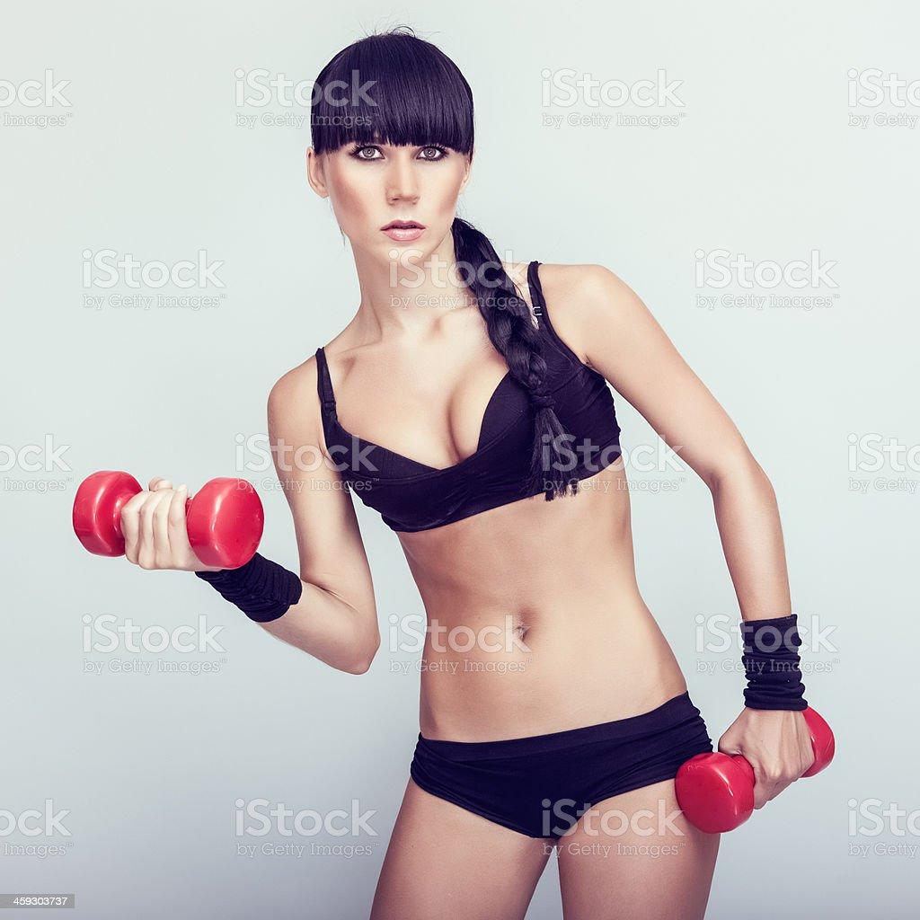 Beautiful  fitness woman exercising stock photo