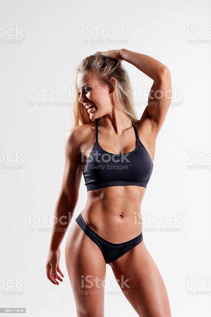 beautiful fitness woman posing on studio background stock photo