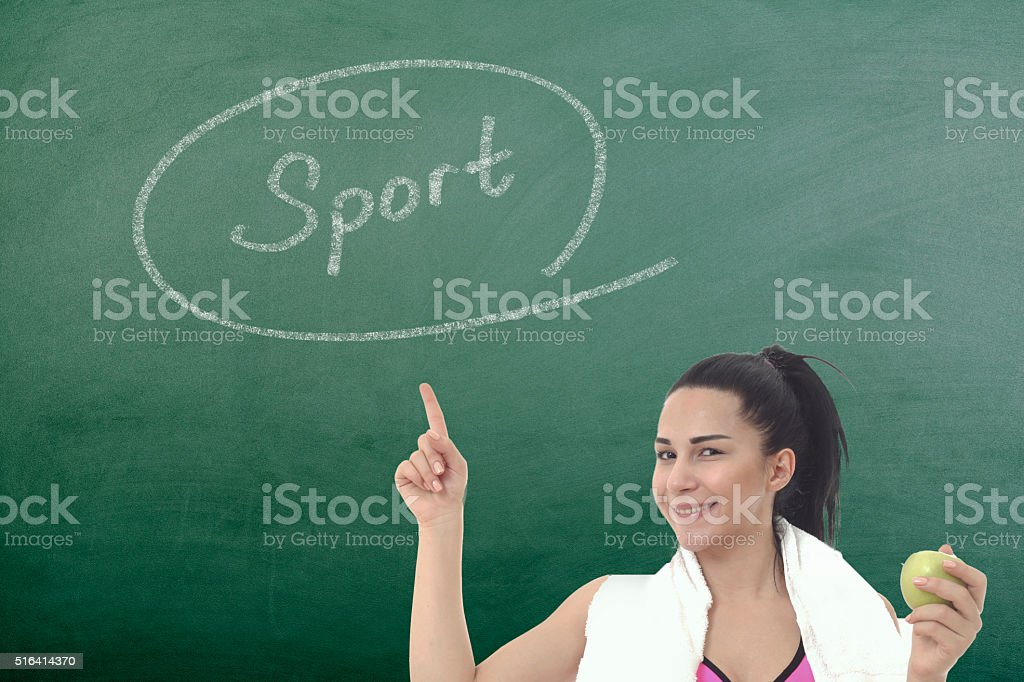beautiful fitness woman thinking on chalkboard stock photo