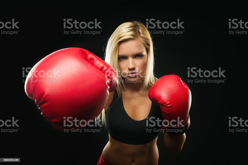 Beautiful Fitness Woman with Red Boxing Gloves is Attacking stock photo