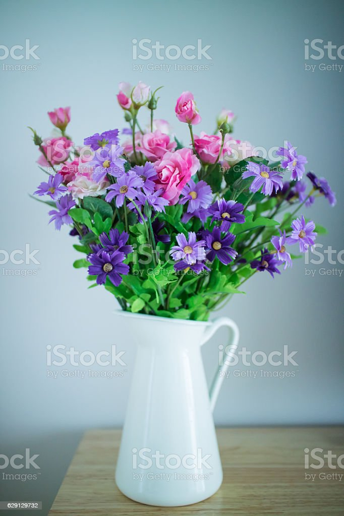 Beautiful flower bouquet on wooden table stock photo