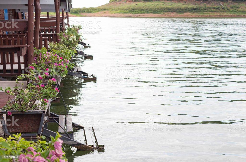 beautiful flower pot in river and sky in summer background Стоковые фото Стоковая фотография